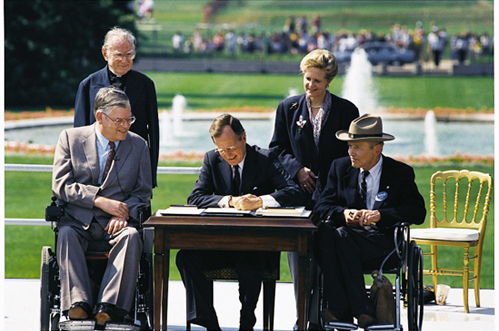 President Bush signs the Americans with Disabilities Act of 1990