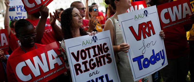 Protesters march in support of the Voting Rights Act.